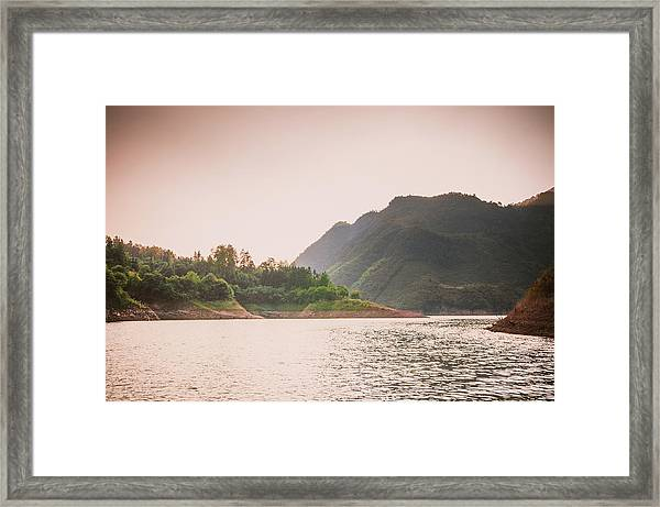 The Mountains And Lake Scenery In Sunset Framed Print