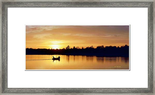 Fishermen On A Lake At Sunset Framed Print