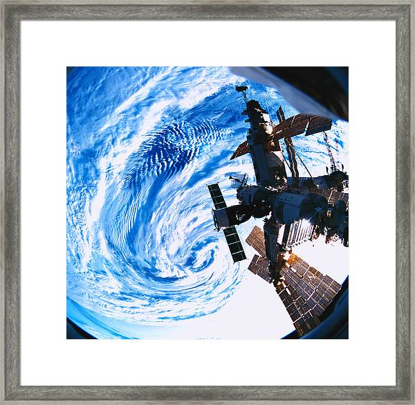 A Space Station Orbiting Above Earth Framed Print