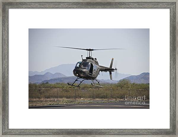 An Oh-58 Kiowa Helicopter Of The U.s Framed Print