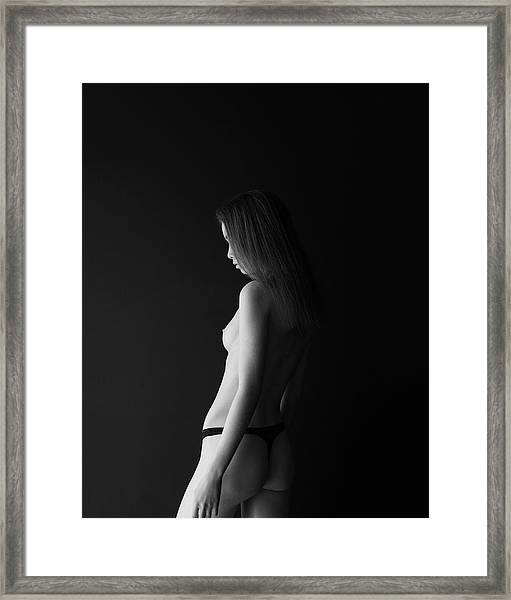 Girl In Front Of Black Wall Framed Print