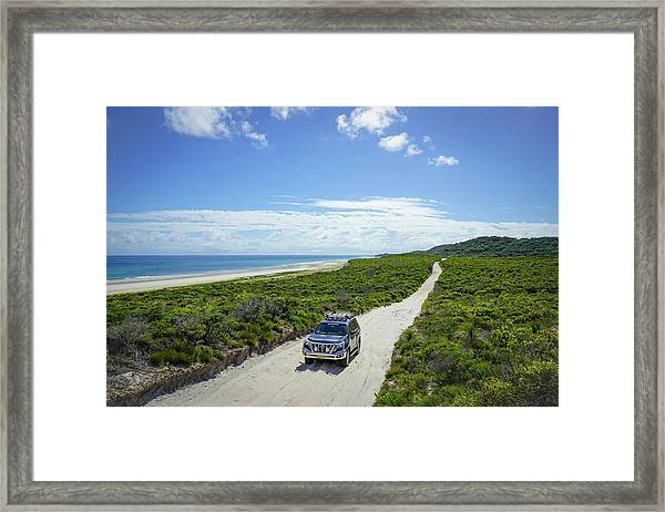 4wd Car Exploring Remote Track On Sand Island Framed Print