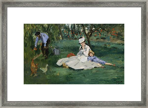 The Monet Family In Their Garden At Argenteuil Framed Print
