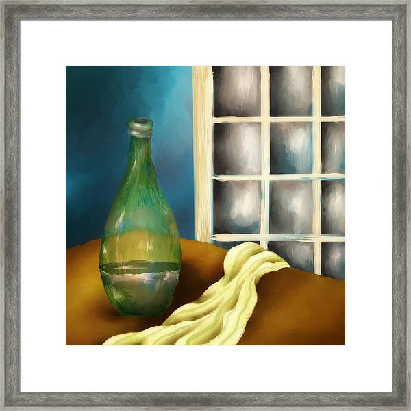 A Bottle And A Towel Framed Print