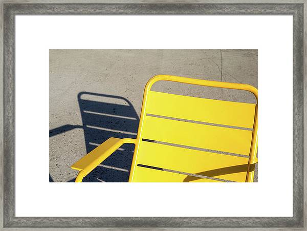 A Chair And Its Shadow Framed Print