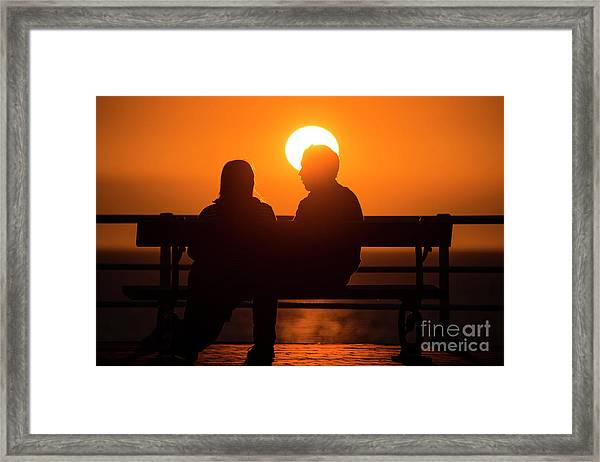 A Couple Sitting At Sunset Framed Print