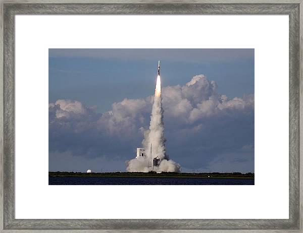 A Delta Iv Rocket Soars Into The Sky Framed Print