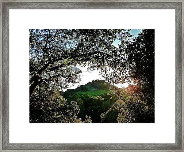 A Distant Cross Framed Print