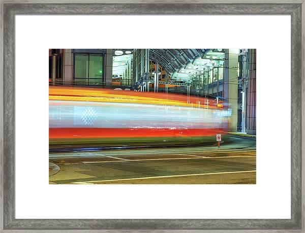 A Downtown Blur Framed Print