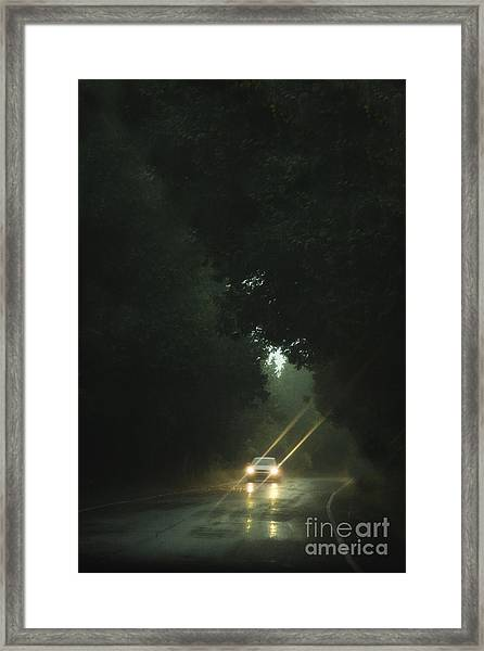 A Drive In The Rain Framed Print