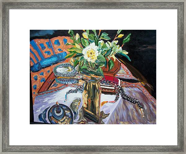 A Flower And A Vase Framed Print