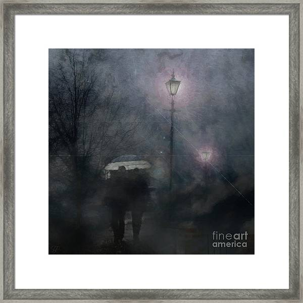 A Foggy Night Romance Framed Print