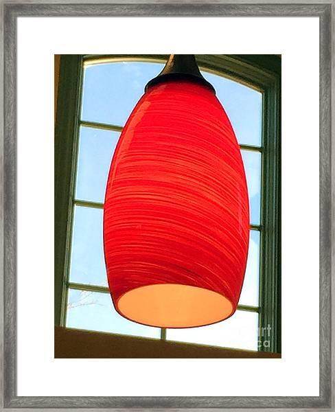 A Light On In Trhe Window Framed Print