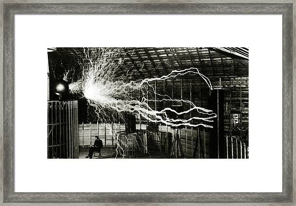 A Multiple Exposure Picture Of Tesla With His Magnifying Transmitter Framed Print