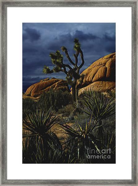 A Mysterious Stormy Desert Sky Framed Print