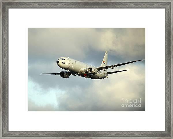 A P-8a Poseidon In Flight Framed Print