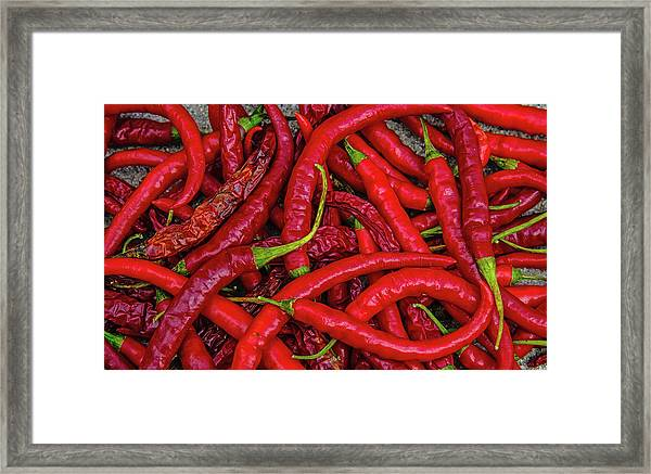 A Peck Of Unpickled Peppers Framed Print