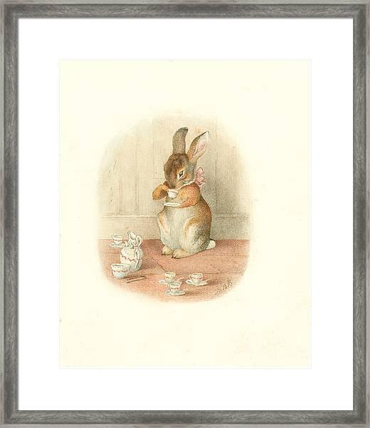 A Rabbit's Tea Party Framed Print