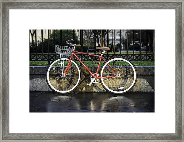 A Red Bicycle Near Jackson Square, New Orleans, Louisian Framed Print