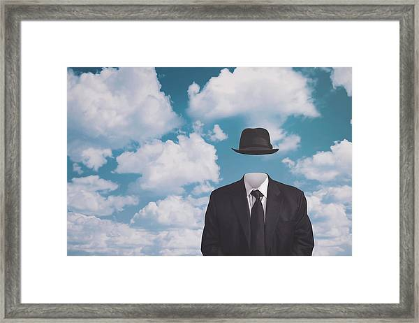 A Riff On Magrittes The Pilgrim Framed Print