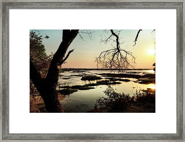 A River Sunset In Botswana Framed Print