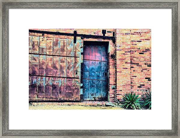 A Rusty Loading Dock Door Framed Print
