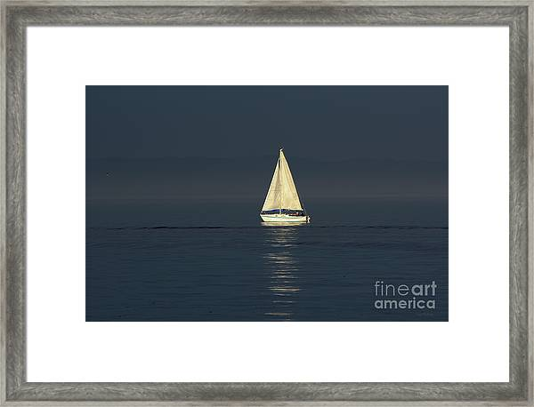 A Sailboat Capturing Light Framed Print