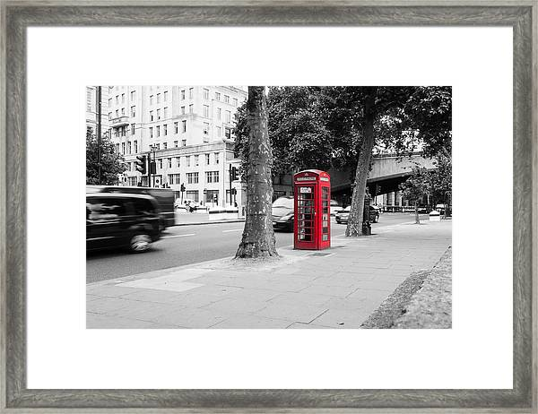 A Single Red Telephone Box On The Street Bw Framed Print