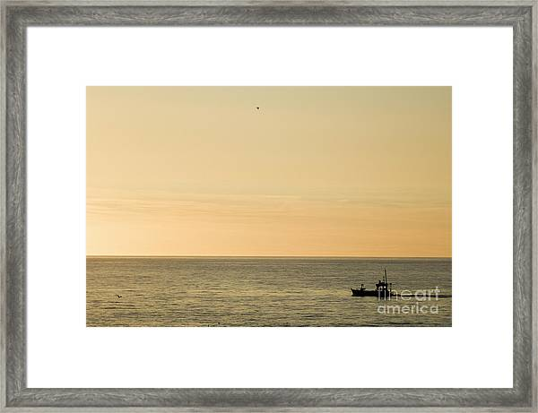 A Small Fishing Boat In Sunset Over Cardigan Bay Aberystwyth Ceredigion West Wales Framed Print