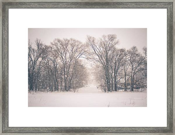 A Snowy Monday Framed Print