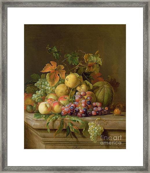A Still Life Of Melons Grapes And Peaches On A Ledge Framed Print