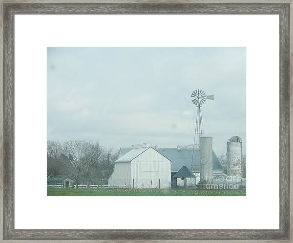 A Storm Moves In Framed Print