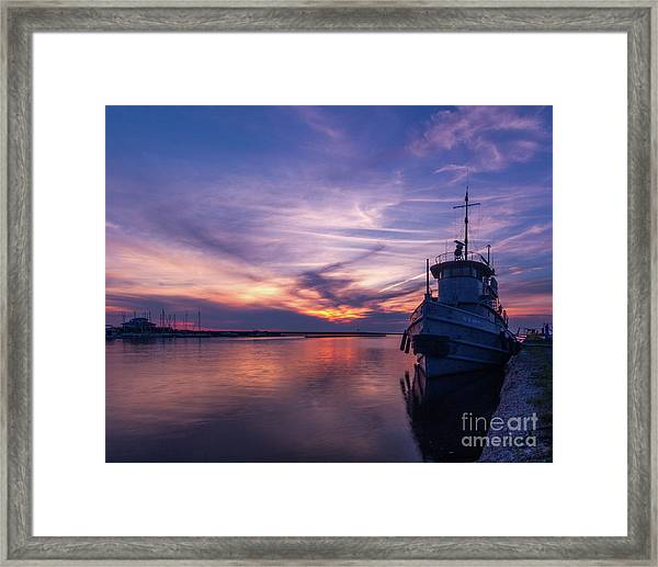 A Tugboat Sunset Framed Print