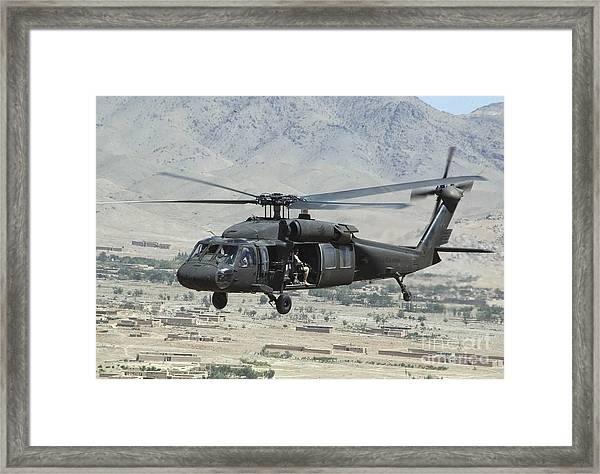 A Uh-60 Blackhawk Helicopter Framed Print