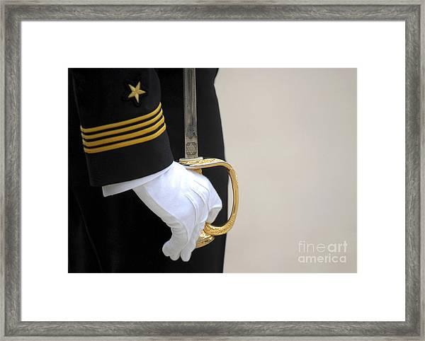 A U.s. Naval Academy Midshipman Stands Framed Print