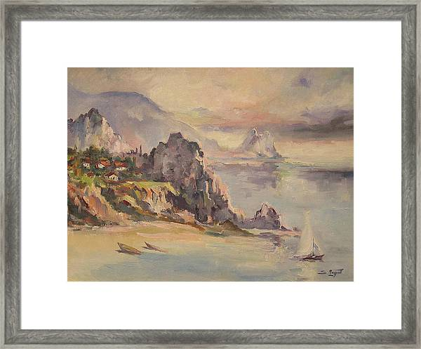 A Village Behind The Cliff Framed Print