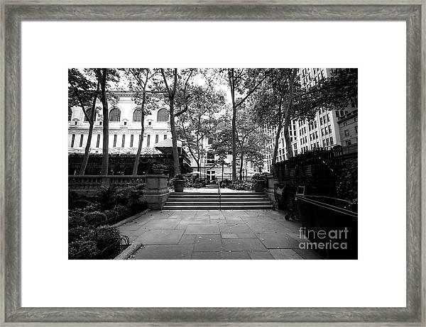 A Walk Through Bryant Park Framed Print by John Rizzuto