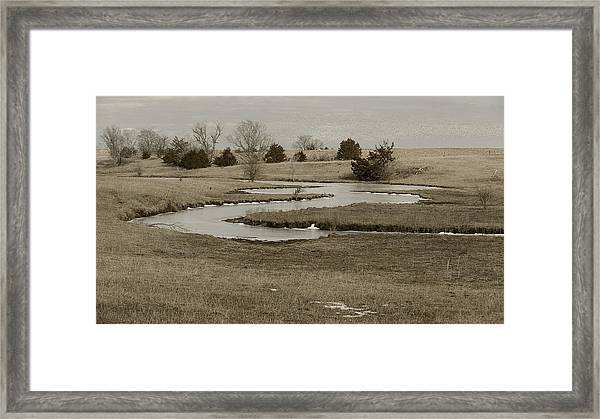 A Winding Creek In Winter As Geese Fly Overhead Framed Print