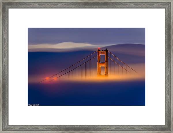 Above The Fog Framed Print