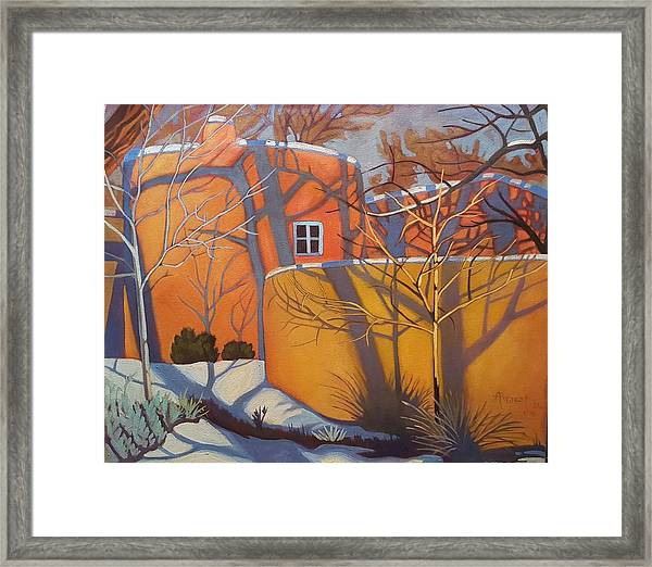 Adobe, Shadows And A Blue Window Framed Print