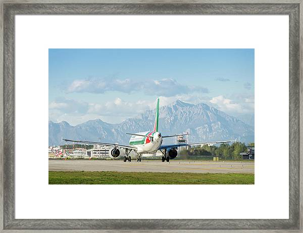 Airplane And Mountains Framed Print