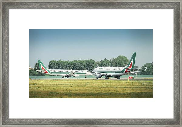 Airplanes That Appear To Be Kissing Framed Print