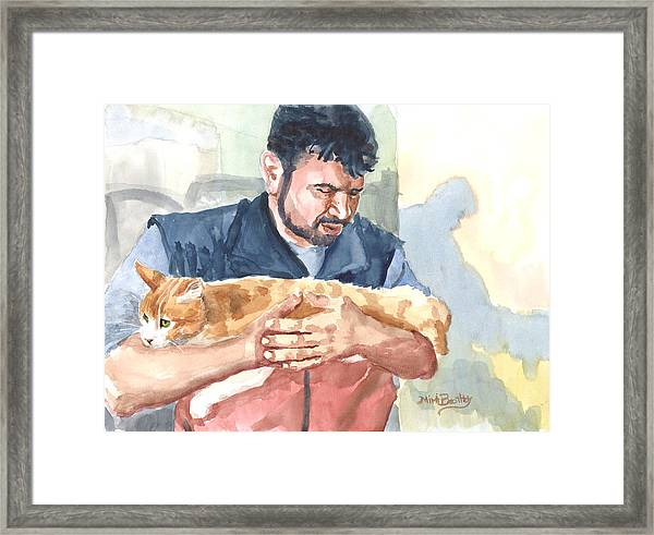 Alaa Rescuing An Injured Cat Framed Print
