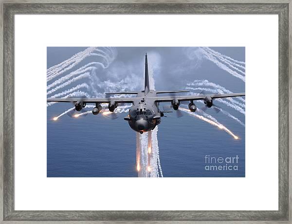 An Ac-130h Gunship Aircraft Jettisons Framed Print