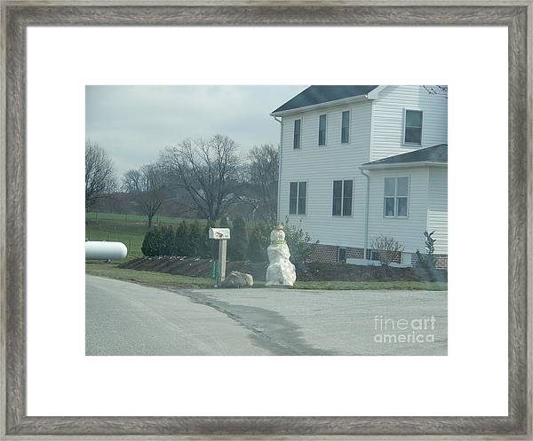 An Amish Snowman Framed Print