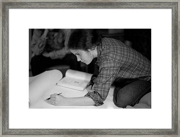 An Artist Draws In Pen And Ink, 1972 Framed Print