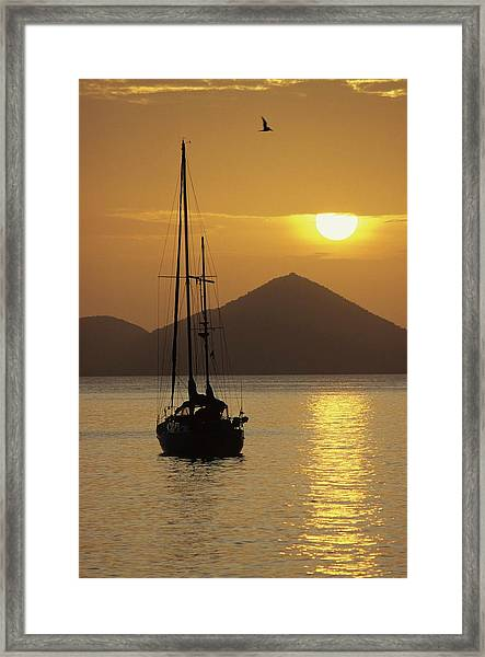 Anchored Ketch And Sunset Over Caribbean Framed Print