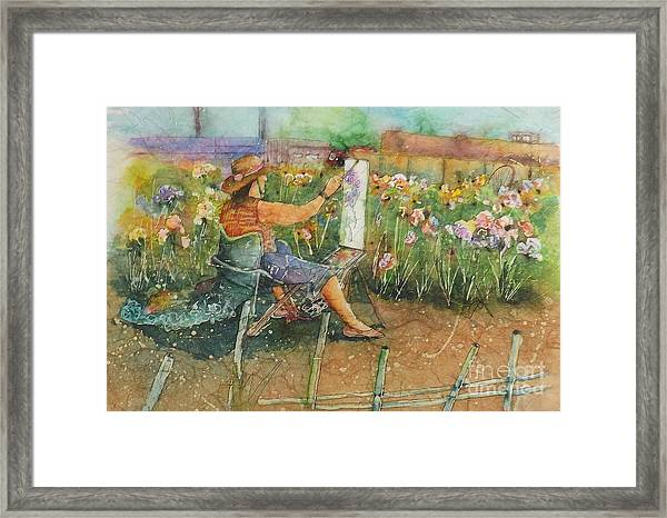 Artist In The Iris Garden Framed Print