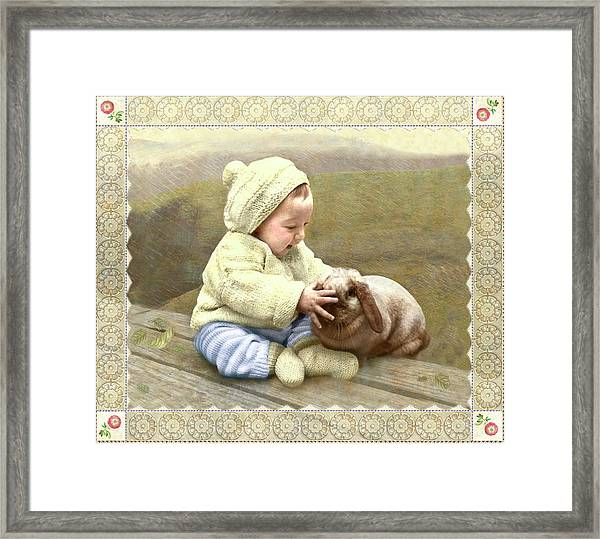 Baby Touches Bunny's Nose Framed Print