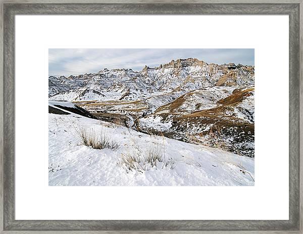 Badlands In Snow Framed Print
